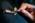 Reportage photographique sur le réseau First TF (temps Fréquence). Cette photographie a été réalisée dans un laboratoire de recherche de l'ONERA, membre du réseau d'excellence FIRST-TF porté par le CNRS. Cellule en cuivre contenant un microrésonateur en quartz avec des électrodes en or. Le vide est ensuite fait dans la cellule.