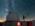 """Reportage photographique """"La tête dans les étoiles"""". Observatoire du Pic du Midi.  Pendant que la caméra enregistre des données, David Darson contemple la Voie lactée."""