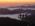 """Reportage photographique """"la tête dans les étoiles"""". Des membres de l'équipe de nuit du Pic du Midi profitent de l'aube qui se lève depuis la passerelle surplombant le versan français des Pyrénées."""