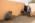 Arabie Saoudite. Madâin Sâlih. Mission archéologique franco-saoudienne dans l'antique cité nabatéenne de Hégra.. Caroline Durand,  Archéologue, céramologue, Laboratoire HiSoMA Maison de l'Orient et de la Méditerranée. et Alain Pierre Photographient un vestige de céramique Nabatéene  en utilisant comme fond une Abaya (robe traditionnelle portée par les femmes en Arabie Saoudite)  Tenue par  Marie Peillet Restauratrice de la monnaie et des objets métalliques.