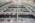 Un laboratoire pour la bombe H. Programme de simulation de l'arme nucléaire. Bordeaux. CEA. site du CESTA. Laser Mégajoule. Un des 4 halls laser de 100 mètres sur 30 destinés à accueillir les chaînes laser et à leur donner leur puissance. Une impulsion lumineuse d'1 joule est émise et amplifiée jusqu'à 20 000 fois dans ce hall en traversant des blocs amplificateurs composés de différentes optiques et de Lampes flashs au xénon qui apportent l'énergie lumineuse . Pour obtenir la puissance souhaitée les faisceaux laser parcourt quatre fois chaque chaîne amplificatrice avant d'entrée de manière parfaitement synchronisé dans la chambre d'expérience et d'être focalisé sur la cible d'hydrogène.
