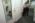 Aéroport Charles-de-Gaulle. À la sortie d'un avion, la police aux frontières contrôle les passeports des passagers à la recherche d'éventuelles falsifications. À gauche, sur la photo, personnes interpellées avec de faux documents.  Charles-de-Gaulle Airport, France. Leaving the plane, the border police control a passenger's passport, looking for traces of falsifications. On the left, passengers found with false papers.