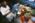 Aéroport Charles-de-Gaulle. Zone de fret. Douanier contrôlant un arrivage en présence du réceptionneur. Contrôle de la conformité du contenu avec la déclaration établie par l'expéditeur.  Charles-de-Gaulle Airport, France. The freight zone. A Customs officer controlling a package in presence of the recipient. He is verifying that the contents correspond to the declaration established by the sender.